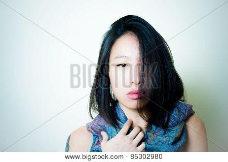 Asian Woman Close Up Looking At Camera