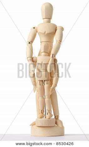 Wooden Figures Of Parent Embracing His Child From Back, Full Body, Isolated On White