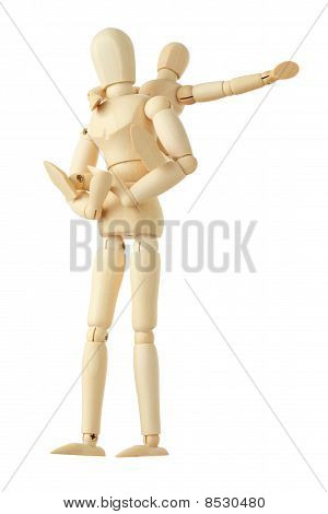 Wooden Figures Of Child Sitting On Back Of His Parent And Pointing For One Hand Right, Full Body