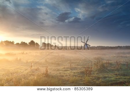 Windmill In Summer Mist At Sunrise