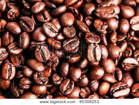 Roasted coffee beans can be used as a background. Closeup macro.