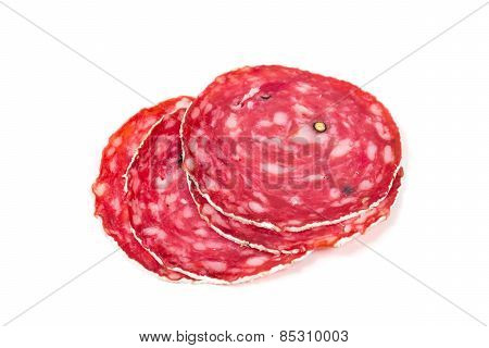 Slices Of Salami Sausage On A White Background