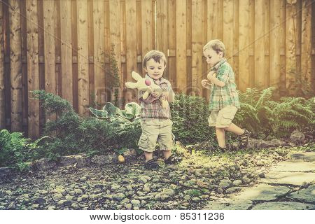 Boys Having Fun On An Easter Egg Hunt - Retro