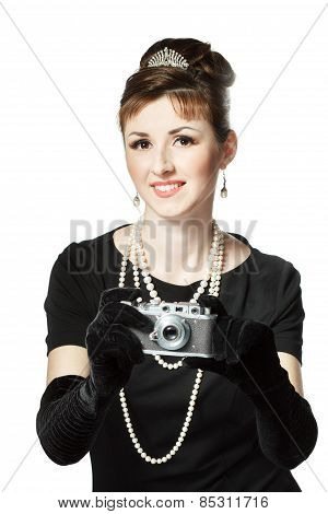 Portrait Of A Beautiful Young Woman With Vintage Camera