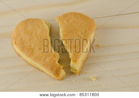 Broken heart cookies love concept on wooden background