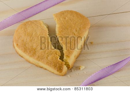 Broken heart cookies on wooden background