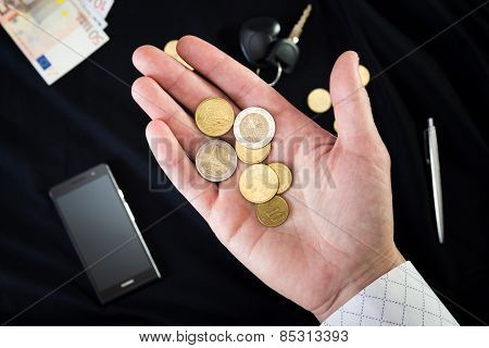 coins on the male palm