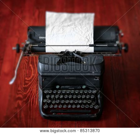 an antique typewriter on a wooden table