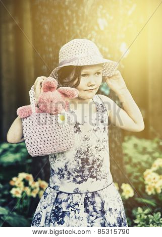 Little Girl Holding A Hand Bag With An Easter Bunny - Retro