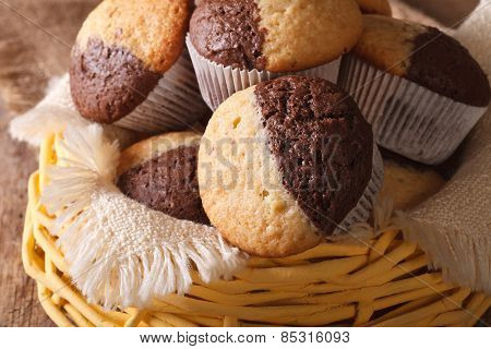 Two-tone Muffins Orange And Chocolate Closeup In Basket