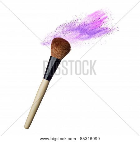 Makeup brushes and powder in motion