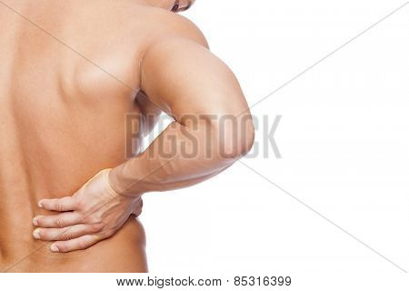 Rear view of a young man holding his back in pain, isolated on white background