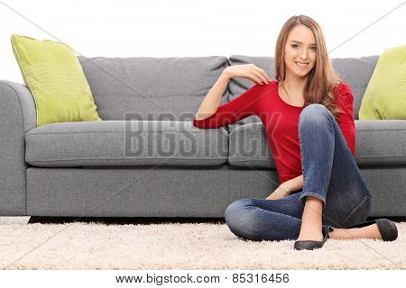 Beautiful woman sitting on a floor isolated on white background