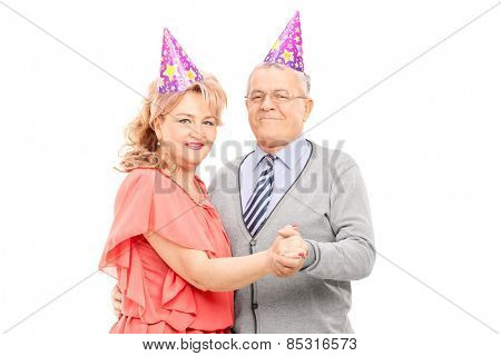 Mature couple dancing at some party isolated on white background