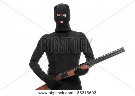 Masked terrorist holding a shotgun isolated on white background