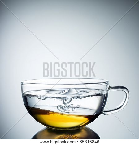 Glass cup of black tea. Isolated on white