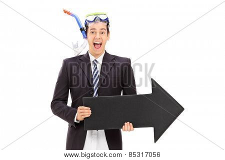 Businessman with diving equipment holding an arrow isolated on white background