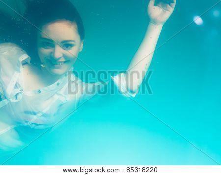 Underwater Girl Wearing Bikini In Swimming Pool