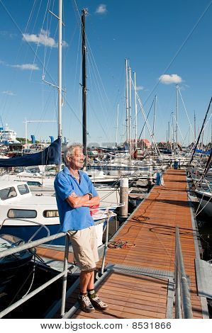 Elderly Man In Harbor