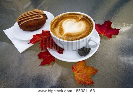 Hot Coffee Latte with Dessert on a Cool Autumn Day
