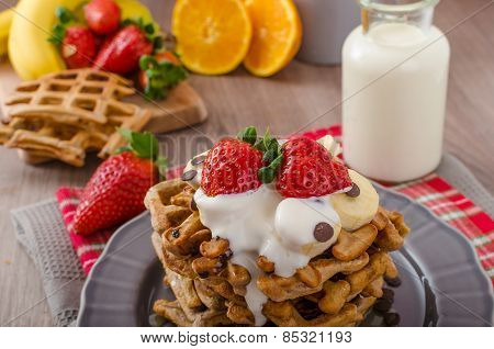 Belgian Waffles With Chocolate Chips And Fruits