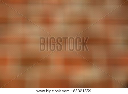Blurred abstract background from a red brick wall