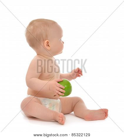 Infant Child Baby Kid Eating Green Apple Blue Eyes Looking At The Corner