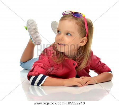 Child Baby Toddler Kid In Red Jacket Lying On The Floor And Happy Looking Up Smiling