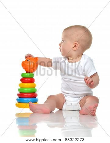 Infant Child Baby Boy Toddler Playing With Pyramid In Hand