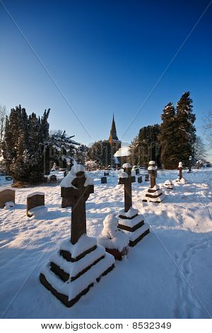 Snowy Churchyard On A Bright Winter Afternoon