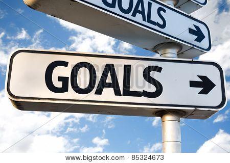 Goals direction sign on sky background