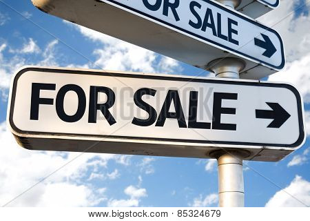 For Sale direction sign on sky background