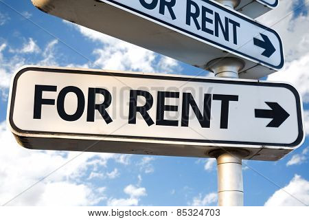 For Rent direction sign on sky background