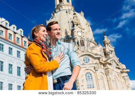 Tourism - couple of man and women at Frauenkirche in Dresden