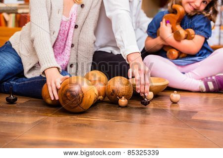 Children playing with wooden toys in store