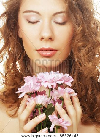 blond girl with pink flower on white background
