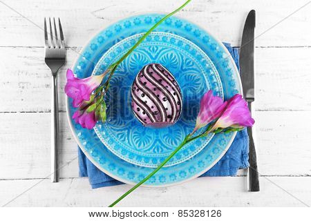 Easter table setting with Easter egg close up