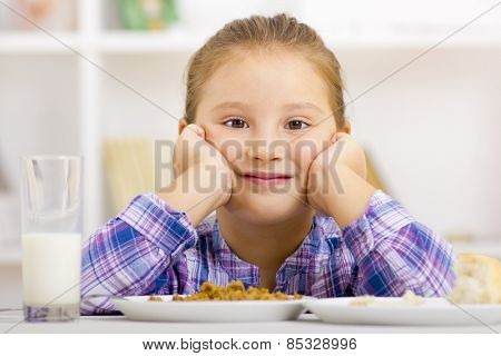 Kid on table with meal