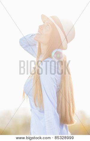 Young girl wearing hat enjoying in beautiful day in nature