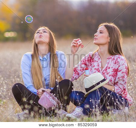 Girl friends outside playing