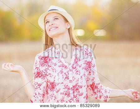 Young girl enjoying in beautiful day in nature