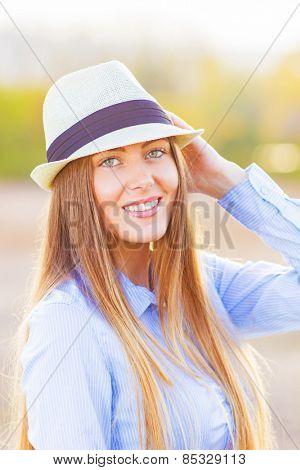Young girl enjoying in beautiful day outside