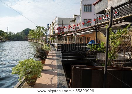 MALACCA, MALAYSIA - JANUARY 29, 2015: On the waterfront Malacca River located hotels, restaurants and cafes. Malacca has been listed as a UNESCO World Heritage Site 2008.