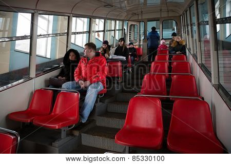 VLADIVOSTOK, RUSSIA - MARCH 8, 2015: Passengers sit in the car funicular. One of the two funicular in Russia,  operation since May 1962.