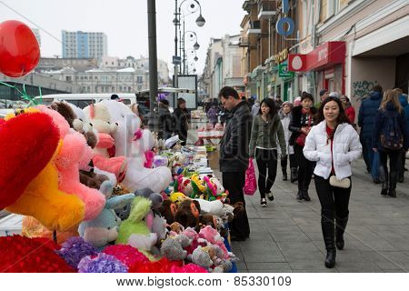 VLADIVOSTOK, RUSSIA - MARCH 8, 2015:City residents and guests in the center of Vladivostok on the Svetlanskaya Street . March 8 is an official holiday in Russia -  International Women's Day.