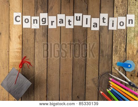 Graduation Cap And Stationery Set  On Wooden Background