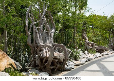 SINGAPORE - JANUARY 27, 2015: Decorative chair made of trunks, branches and roots of trees. Several similar chairs set in the park Gardens By The Bay  in Singapore.