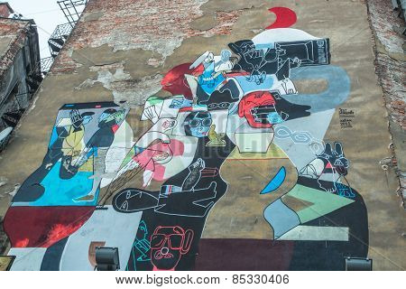 KRAKOW, POLAND - FEB 13, 2015: Mural street art by unidentified artist in jewish quarter Kazimierz. Since the 1818 year Kazimierz is part of the Krakow Old town, now a UNESCO world heritage site.