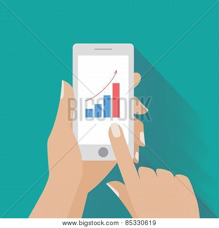 Hand holing smart phone with increasing bar chart on the screen