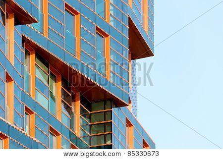 Modern building mirror facade in blue tone